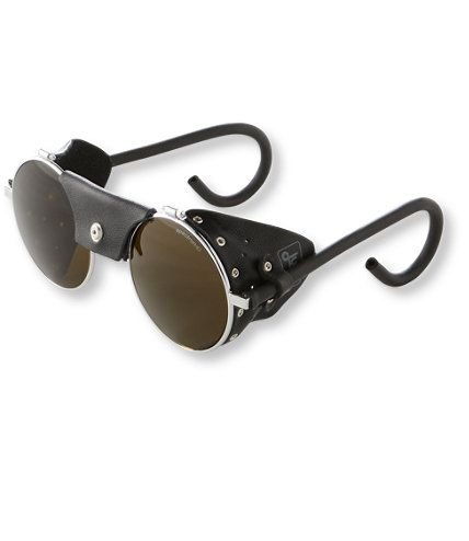 These classic mountaineering sunglasses provide exceptional coverage in bright conditions like sun reflecting off snow and water. Spectron 4 polycarbonate lenses block 100% of the sun's harmful rays and 95% of its visible light. Vented leather side shields block peripheral light. Traditional mountaineering frame with round lens and moldable ear pieces. Imported.