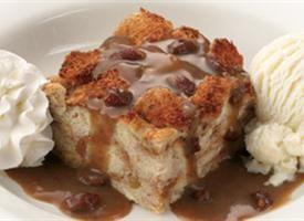 Famous Dave's bread pudding!  OH. MY. GOODNESS.  THIS is the recipe!!!  Made it tonight and it tastes just like the bread pudding you get at Famous Dave's.    A few changes to the recipe:  I halved it (and still had a quart jar of the sauce left over!), baked it in an 8x8x2 inch glass baking dish for 1 hour and 20 minutes - first hour with foil covering, 20 minutes without.