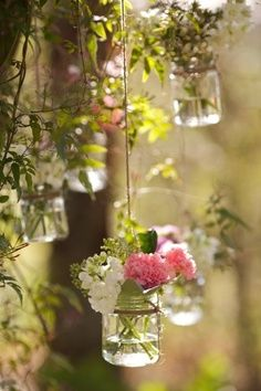 hanging flowers arrangement... love this idea for a wedding reception. via Aphaphat Wiwekkhunsri. Love this idea for anytime and all summer. Hang around the patio.