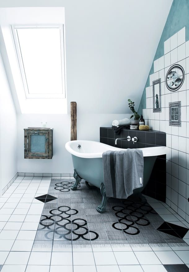 Scandinavian, maritime and delicate bathroom with bathtub with claw feet and tiles with a graphic and playful look.