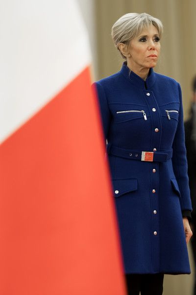 Brigitte Macron Photos - French President Emmanuel Macron's wife Brigitte Macron loos on during a welcoming ceremony inside the Great Hall of the People on January 9, 2018 in Beijing, China. - French President Emmanuel Macron Visits China