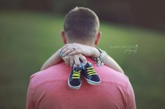 Pregnancy detail photo with baby shoes baby accessories. Pregnancy poses and…