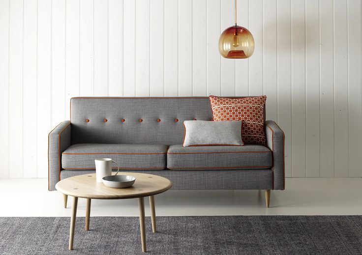 Tonic textile by Instyle - From the sustainable LIFE Textiles collection, Tonic is a highly versatile and classic textile with a refined pebble texture. Pictured on Southwood's Dalton sofa is Tonic Fix in grey with Sense Creativity in orange piping.