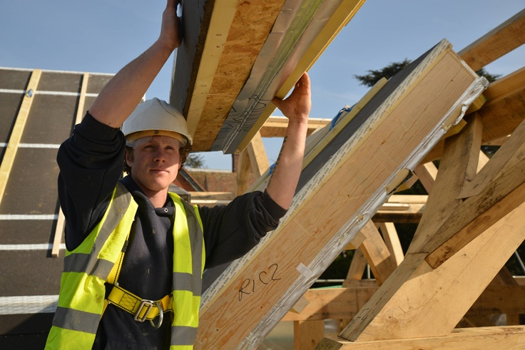 Oakwrights on site team members fitting the 'Natural' roof encapsulation system