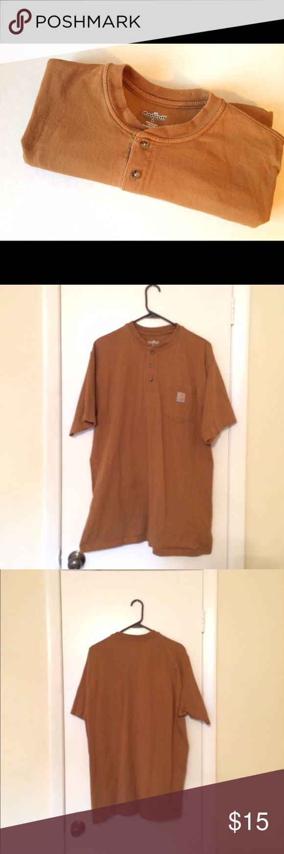 Men's Carhartt Shirt A Men's Carhartt Shirt Sleeve Shirt. In a size L. In great condition, but there is a small paint on the bottom back of the Shirt. Price is negotiable so make me an offer.👍🏻 Thank you.☺️ ❌No Trades❌ Carhartt Shirts Tees - Short Sleeve