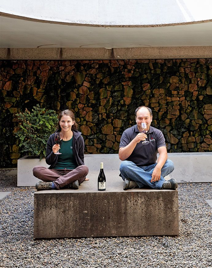 Winemakers Rosario Álvarez and Julio Bastías chill out with a glass in the naturally cooled production facilities of Matetic Vineyards. Read more: http://enroute.aircanada.com/en/articles/winemaking-in-chile #chile