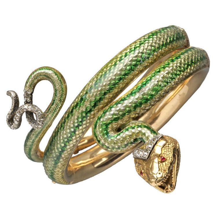 A French gold, ruby, diamond and enamel bangle in the form of a serpent, c.1865; (love the enamel and the nasty little teeth.)