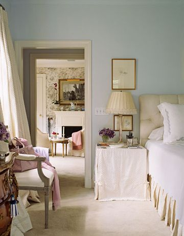 """The walls in this master bedroom are painted Marilyn's Dress by Benjamin Moore. The bedside tableskirt is Diamond Patchwork dupioni silk from the Silk Trading Co. Bedside lamp is by Vaughn. Bed linens and sham are Matouk."""