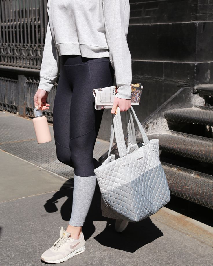 MZ Wallace Oxford Metro Tote in custom grey colorblock for Equinox gyms, leaving the Soho location on Crosby Street, New York City.