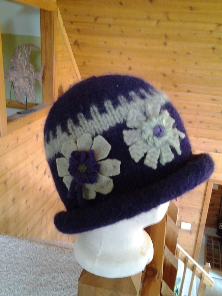 Added some design into the knit hat prior to felting.  Wool fabric designed flowers with vintage buttons  Nice thick rolled brim!
