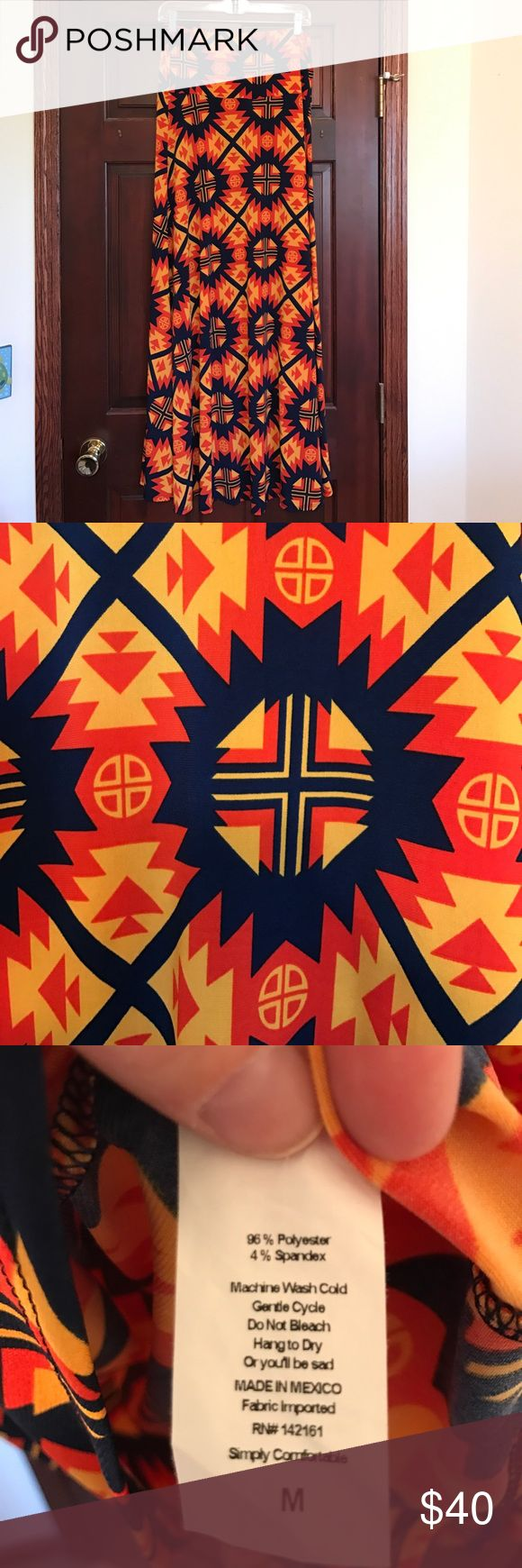 LuLaRoe Maxi skirt size Medium Awesome LuLaRoe maxi skirt (can also be worn as a strapless dress) size Medium.  Perfect condition worn just once.  Super fun southwest/Aztec design.  Navy blue, orange and yellow. LuLaRoe Skirts Maxi