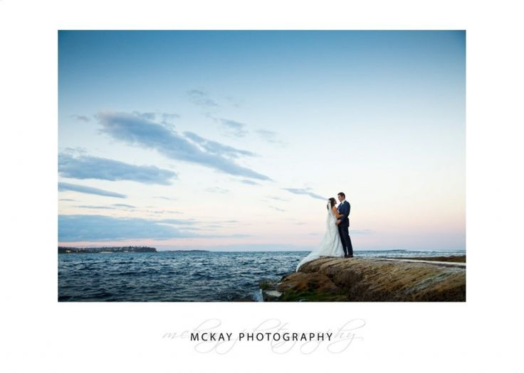 Sunset wedding photo at Fairy Bower Pool in Manly