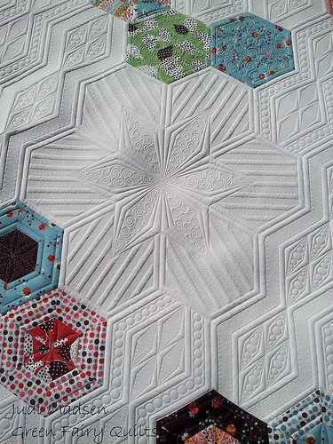 Judi Madsen made a flower quilting design within the hexagon quilt shape.