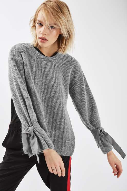 It's all about the cuffs with this super-soft mid weight knit jumper. In a wintery charcoal hue, it comes with side-vents and grosgrain tie detail to the sleeves. #Topshop
