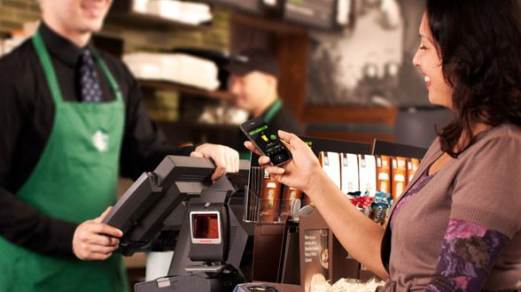 STARBUCKS has a mobile app that you can pay with your phone and earn free coffee.  If your a coffee junkie like me this is a must have app!