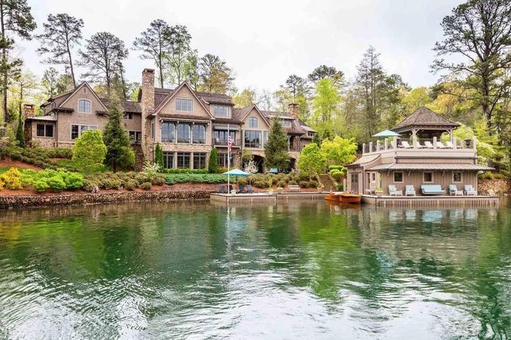 Exterior - Alan Jackson is Selling His Georgia Lake House for $6.4 Million - Southernliving. The home sits on a 1.2 acre manicured lot that offers incredible views of the lake and mountains.