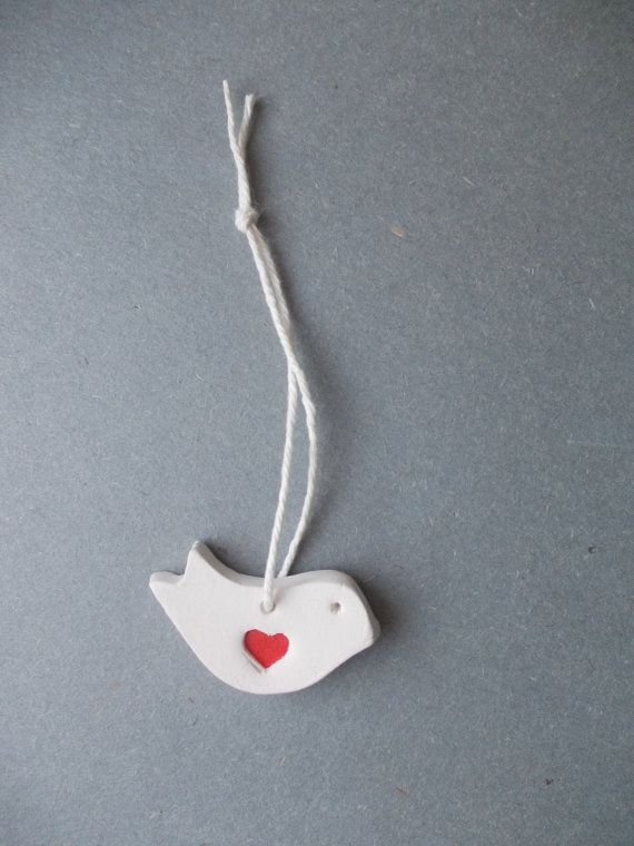 Set of 5 Ceramic Love Birds with red heart. Ready to ship. Please convo if You need more. For larger quantity will be better price.  Measurements: approx 1 1/2 x 3/4  I made these little ones from White stoneware clay and fired in 1000 C . The Birdy have a wonderfull linen print on a
