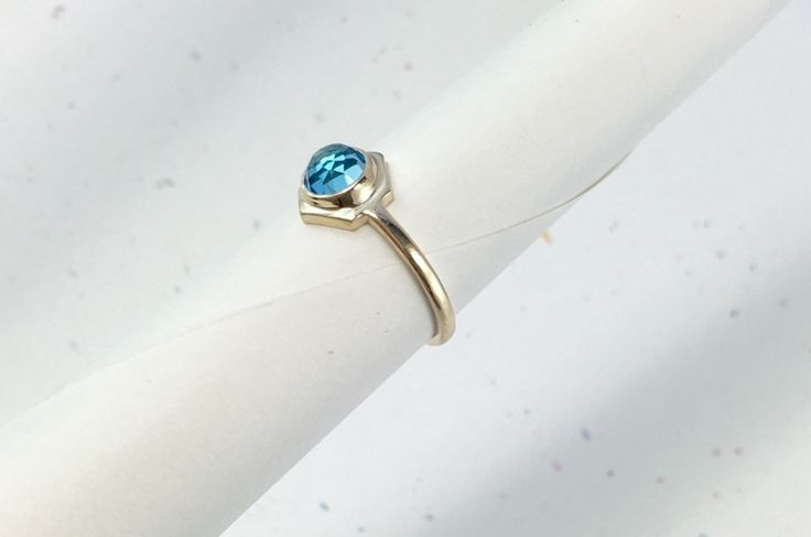10k yellow gold Single Hex ring w/ 6mm rose cut Swiss Blue Topaz.