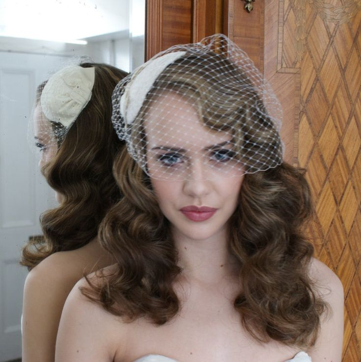 Ivory Birdcage veil with Lace and silk Fasinator.vintage style Bridal Headpiece with silk bow. white ,champagne, cream, black. $230.00, via Etsy.