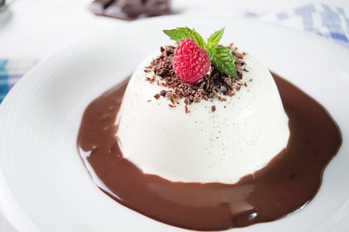 Traditional Italian Panna Cotta with Chocolate Sauce (Panna Cotta con Sciroppo di Cioccolato) | Enjoy this authentic Italian recipe from our kitchen to yours. Buon Appetito!