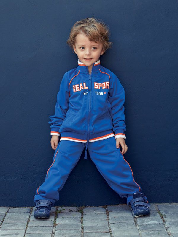 Neil (2) is sporty in a tracksuit top, and matching pants from Pick n Pay Clothing. His Renbut shoes, are from Blue Sunrise.