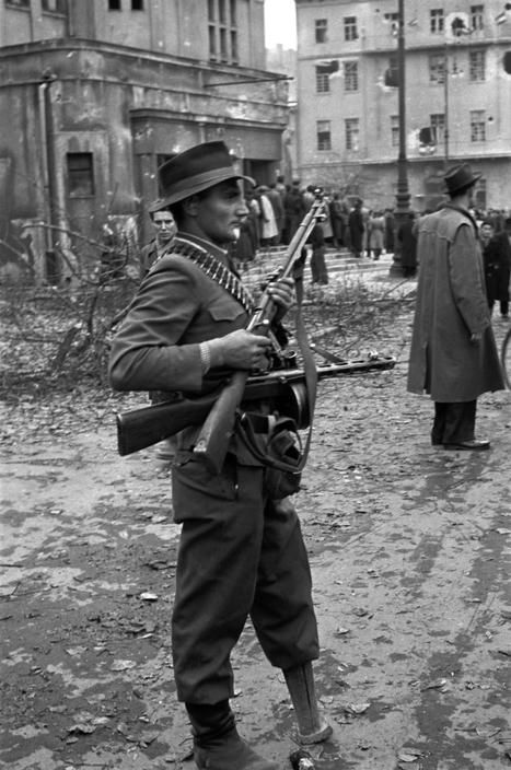 """Janos Mesz, also known as """"Janko of the wooden leg"""", one of the leaders of the rebel group Corvin Lane, stands at the Erkel Theatre on Koztarsasag Square during the 1956 insurrection.in Budapest (Erich Lessing)"""