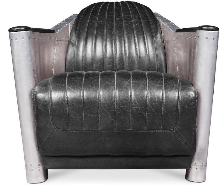 Reposez-vous aux creux des coussins rembourrés recouvert de cuir premium noir d'excellente qualité. Sa structure en bois est très solide et stable, elle soutient une assise moelleuse qui vous garantit confort et détente. Les accoudoirs de ce fauteuil atypique sont acier inoxydable ce qui lui donne un côté futuriste et moderne.   General H 73 x L 75 x P 91 cm Siège  L 62 x P 59 cm  Dossier H 45 cm Poids36Kg Revêtement : Cuir premium Remplissage : Mousse Structure : Bois Pieds : Aluminium