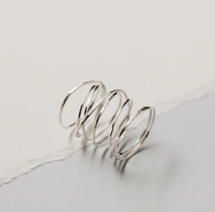 Flexible, and therefore adjustable, spiral ring by SOTINE.  Material: 92.5% silver  Designed in: The Netherlands  Crafted in: The Netherlands