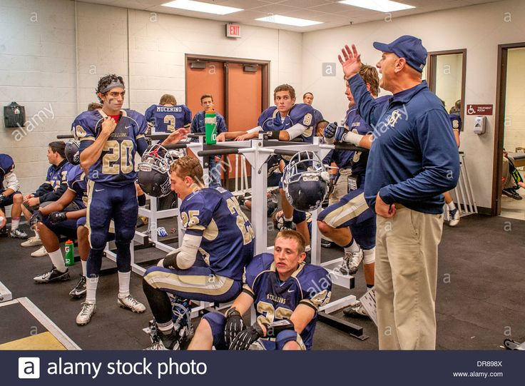 A high school football coach inspires his players in the locker ...
