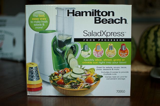 Hamilton Beach SaladXpress Review from Food in Jars:  What I like about it is that it has a smaller footprint than a traditional food processor, dispenses right into your mixing bowl or saute pan, and cleans up more quickly than any food processor I've ever used. I'm totally smitten by the crinkle cut blade, because it means that I can give my pickles a classic wavy edge, also the slices can go straight into my dehydrator for drying.