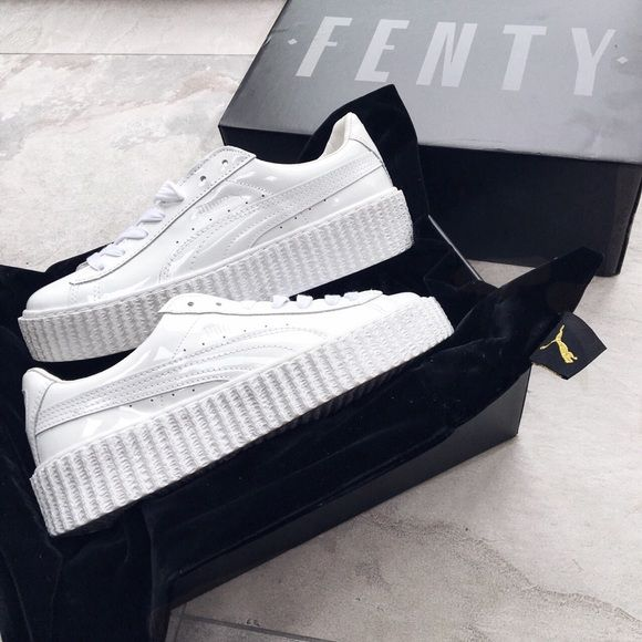 PUMA Basket Glo White Creepers Rihanna 7 new size 7 comes with bag, box & reciept if needed. 100% authentic, bought straight from SIX:02. Any questions feel free to ask. All pictures are mine. If you see any other post with my pictures please notify me & beware that the posibility of that poster being fraudulent is high. If interested comment before purchasing. No trades Puma Shoes Sneakers