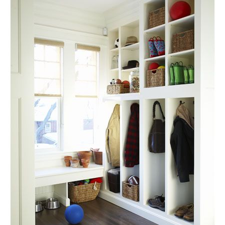 Mudroom with lots of shelves. We need to store umbrellas, shopping bags, stuff to return to library and stores. Also need space for coats, backpacks, and bags.