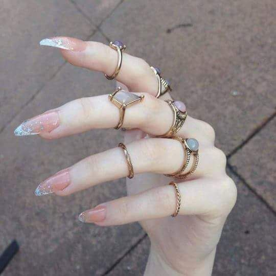 Pastel pink witchy nails with rings