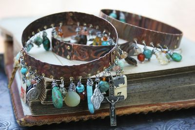 Bangle. Dremel holes in copper band and wire wrap beads, semi precious stones, found objects, etc