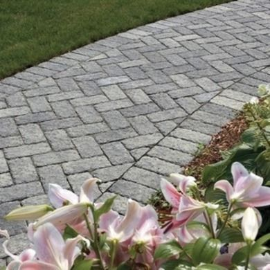 Cassova With its graceful simplicity and weathered, dimpled surface, Cassova resembles the traditional Brussels paver.  It can be configured into a variety of designs, including herringbone, basket-weave, running bond or stacked-bond patterns. It also makes a great soldier course (a border to contain a gravel walk) or accent for other pavers. Unilock Photo: Unilock
