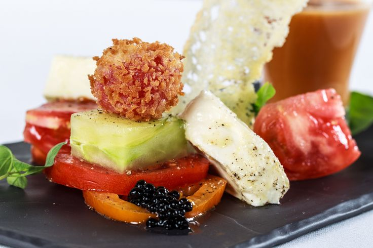 Heirloom tomato salad, smoked fior de latte cheese, balsamic pearls and crisp cherry tomato.