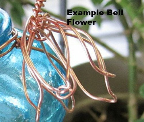 This glass #hummingbird #feeder is made of an aqua jar accented with brass, copper or nickel wire. First you choose your bottle, then choose the wire and your choice of bell ... #decorative