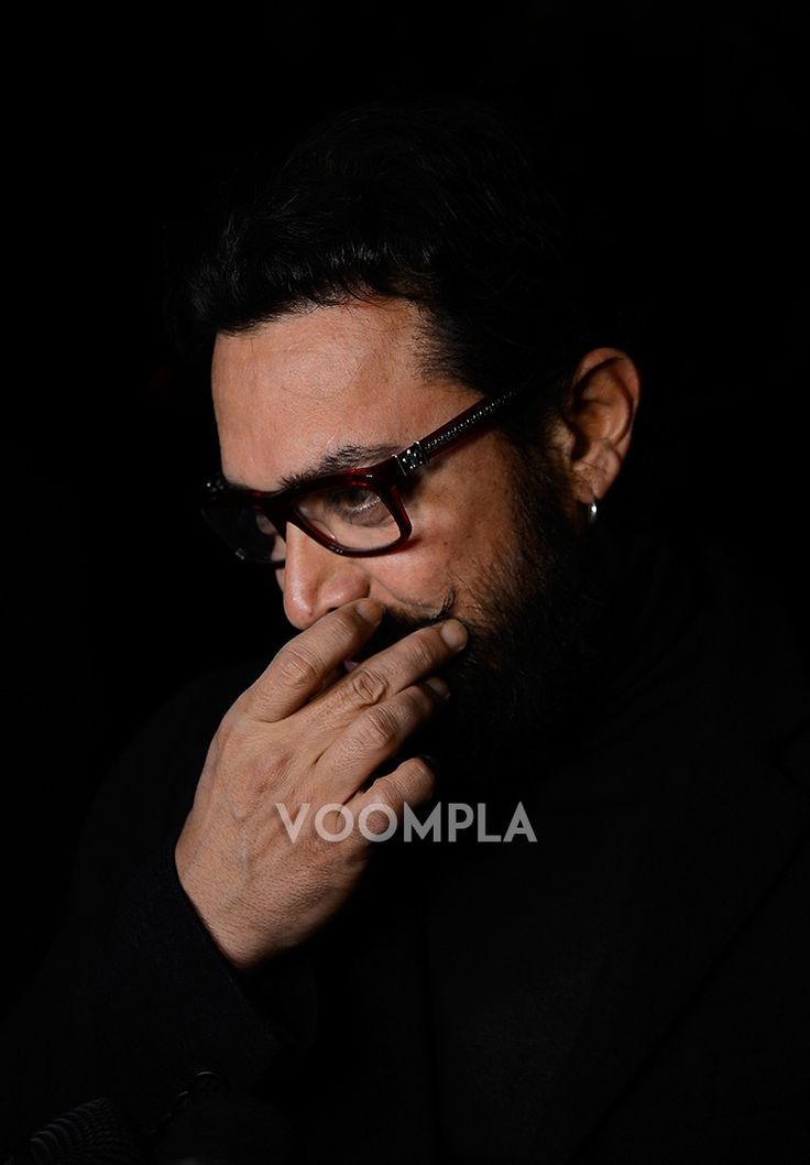 Candid pic of Aamir Khan playing with his moustache... via Voompla.com
