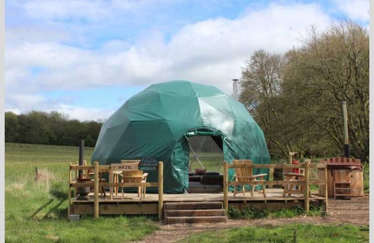 Stylish glamping in Powys, Wales, featuring seven geodomes with private wood-fired hot tubs and firepits, positioned in an eco-friendly award-winning site in the Welsh woodlands, near the Brecon Beacons and the River Wye.  #VisitWales #DiscoverCymru #croeso #petfriendly #dogfriendly #glamping #geodome #NewtoHU #HostUnusual #ecoretreat #ecofriendly