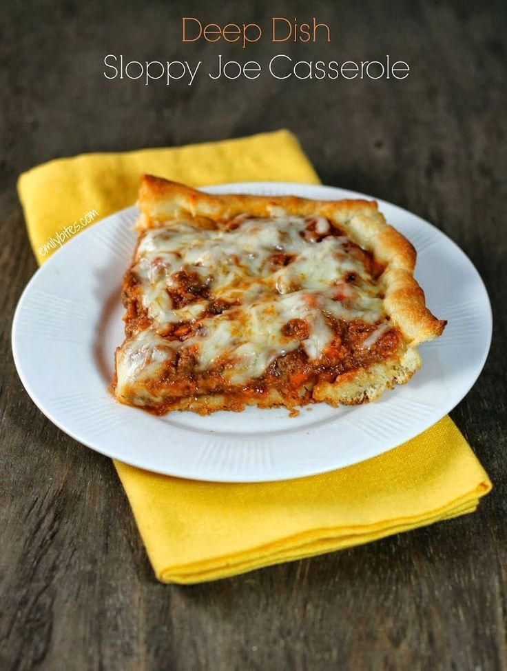 Deep Dish Sloppy Joe Casserole - pizza crust willed with rich saucy meat and veggies and topped with melty cheese. Just 356 calories or 9 Weight Watchers points for a big serving! Lots of hidden vegetables. www.emilybites.com #healthy