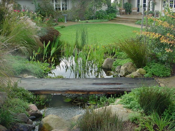 Beautiful backyard landscaping frantz landscapes water for Still pond garden design