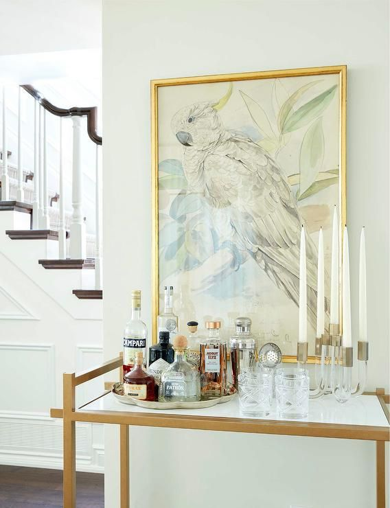 Chic Dining Room Boasts A Brass Bar Cart Lined With Sterling Silver Scalloped Tray