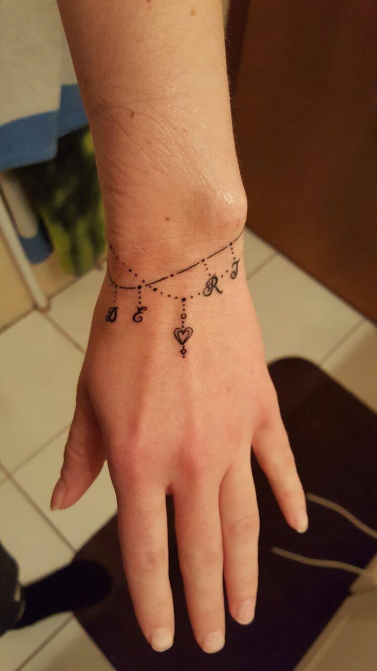 Charm bracelet tattoo.