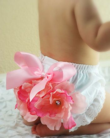 TO DO: Fancy-up sweet little undies as a great gift. Cute idea, but I will use different fabrics and make ruffles or nicer flowers - maybe make printed fabric flowers by hand instead of pre-made ones... #DIY