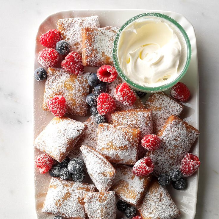 Springtime Beignets & Berries Recipe -I've always loved beignets, but never thought I could make them myself. Turns out they're easy! Sometimes I'll even make a quick berry whipped cream and pipe it inside for a fun surprise. —Kathi Hemmer, Grand Junction, Colorado