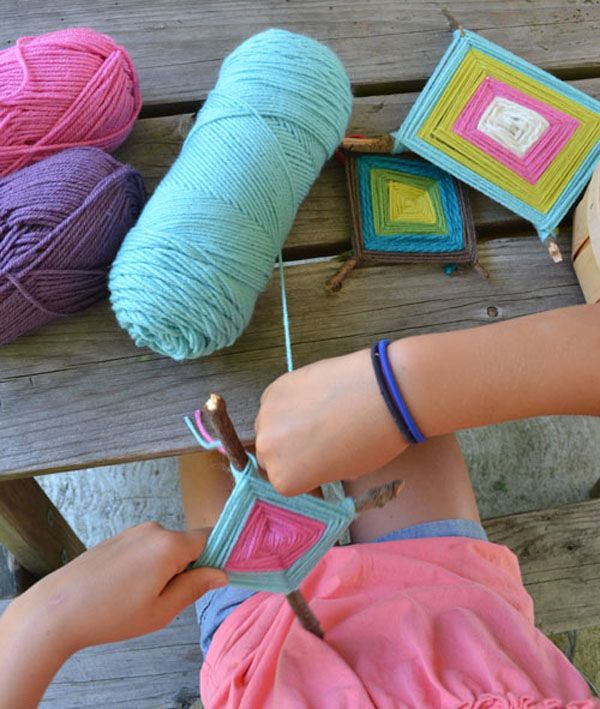 Make these God's eyes with kids using yarn and sticks.