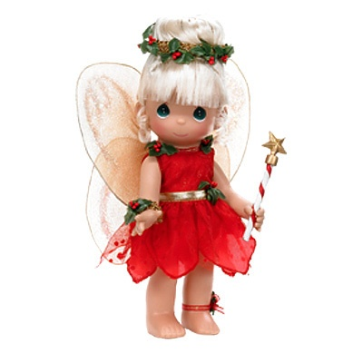 This is a 2009 Precious Moments, Inc./Disney 9 In. Christmas Dreams Tinkerbelle doll. She is adorable and is listed at $29.00 plus shipping.