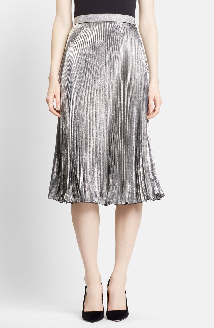 Metallic skirts are one of the seasons' biggest trends, and this Christopher Kane silvery lamé midi skirt is perfect for F/W '15. The delicately accordion pleats play up its light-catching effect.