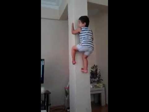 Baby climbing in a concrete pillar!