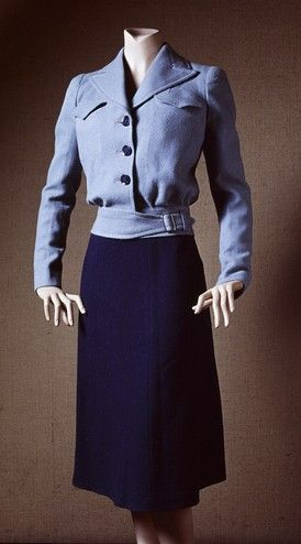 A London made utility dress from the 40s. The style was to conserve fabric for the war effort, though style itself, as you can see, was not needlessly sacrificed for the war uniform dark light blue jacket skirt